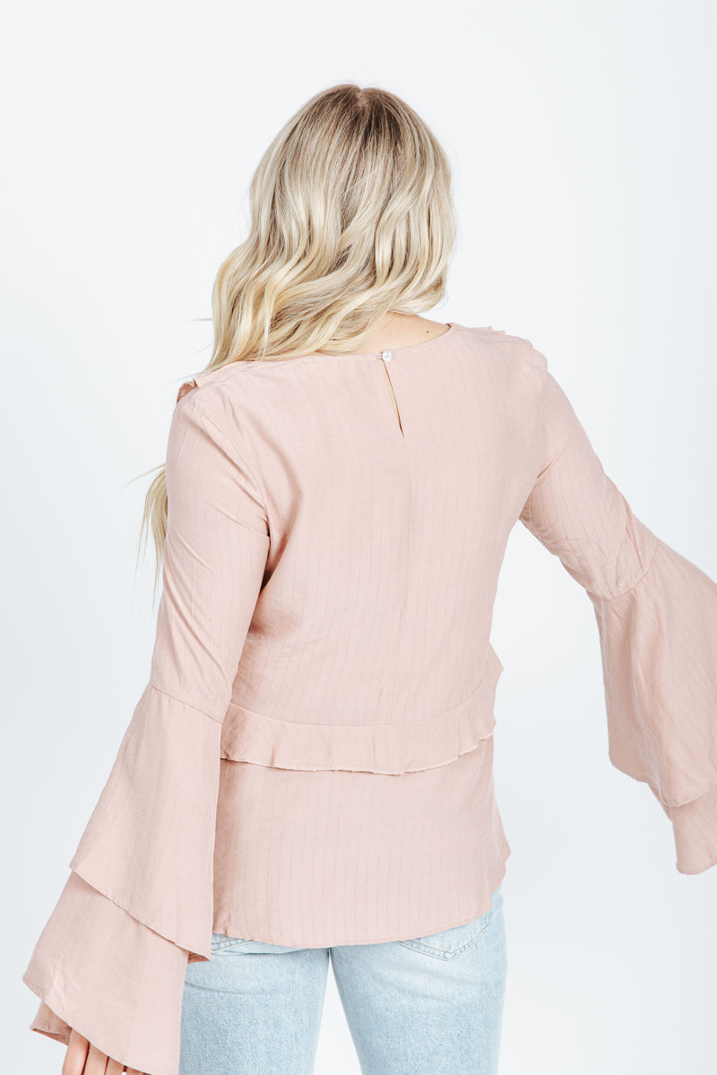 The Owen Bell Sleeve Blouse in Dusty Rose, studio shoot; back view