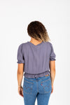 The Denise Smocked Lace Blouse in Slate, studio shoot; back view