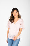 The Morgan Lace Flutter Blouse in Blush, studio shoot; front view