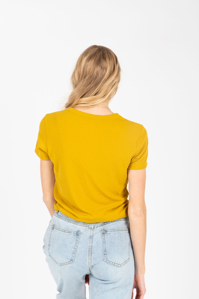 The Rae Crew Tee in Mustard, studio shoot; back view