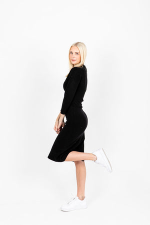 The Horace Collared Button Dress in Black, studio shoot; side view