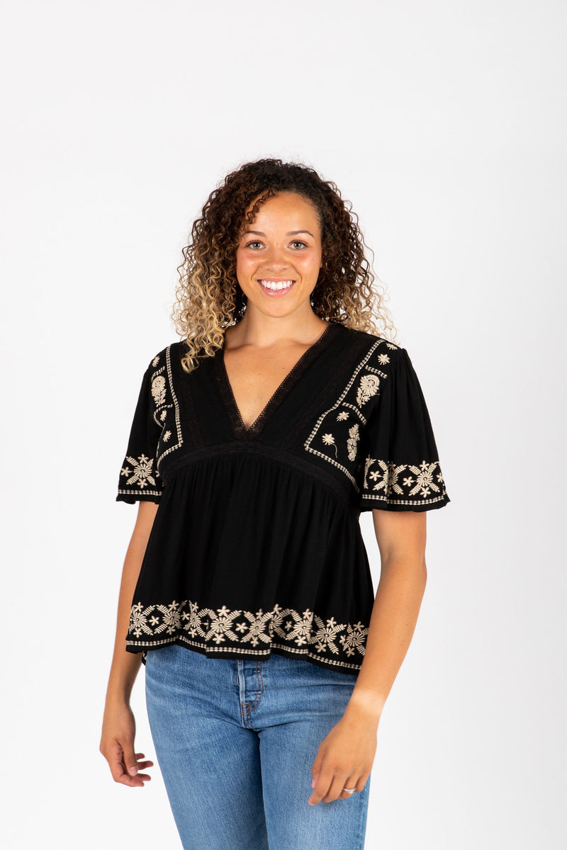 The Tempo Embroidered Blouse in Black, studio shoot; front view