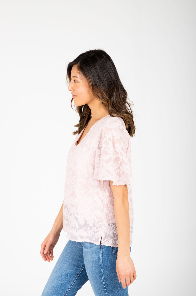 The Morgan Lace Flutter Blouse in Blush, studio shoot; side view