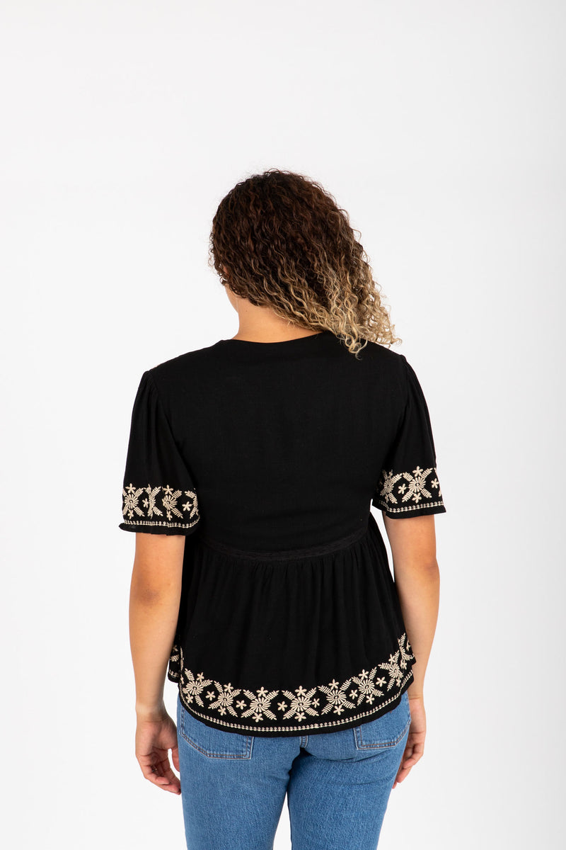 The Tempo Embroidered Blouse in Black, studio shoot; back view