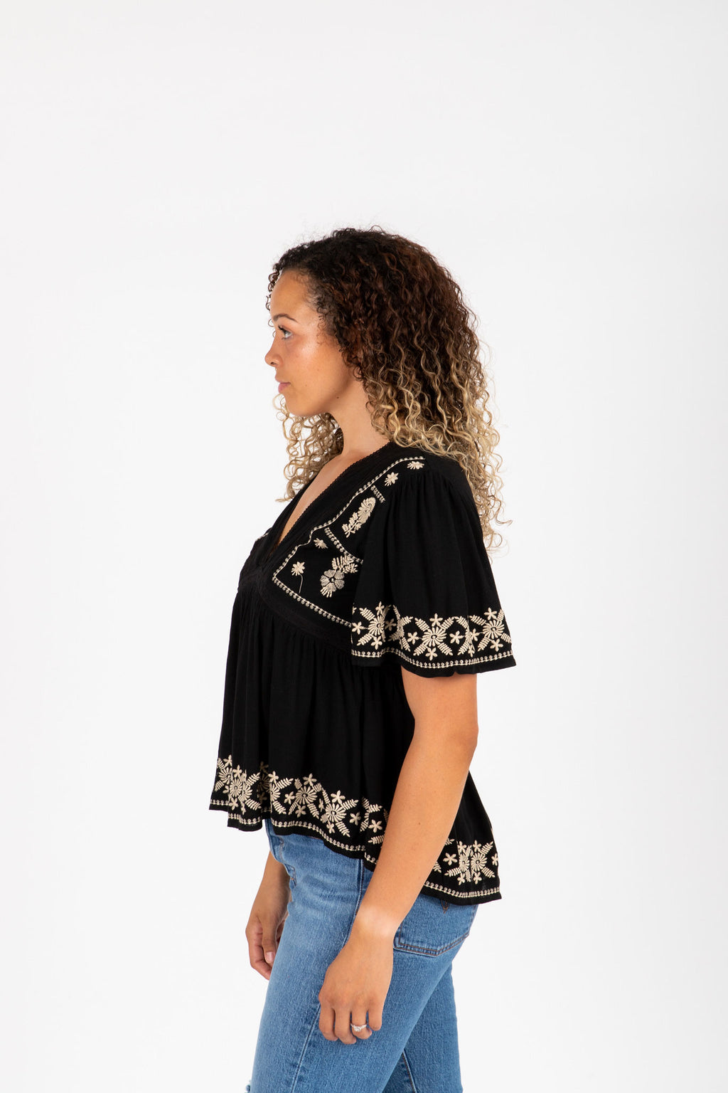 The Tempo Embroidered Blouse in Black, studio shoot; side view
