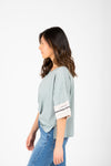 The Finley Striped Boxy Tee in Sage, studio shoot; side view
