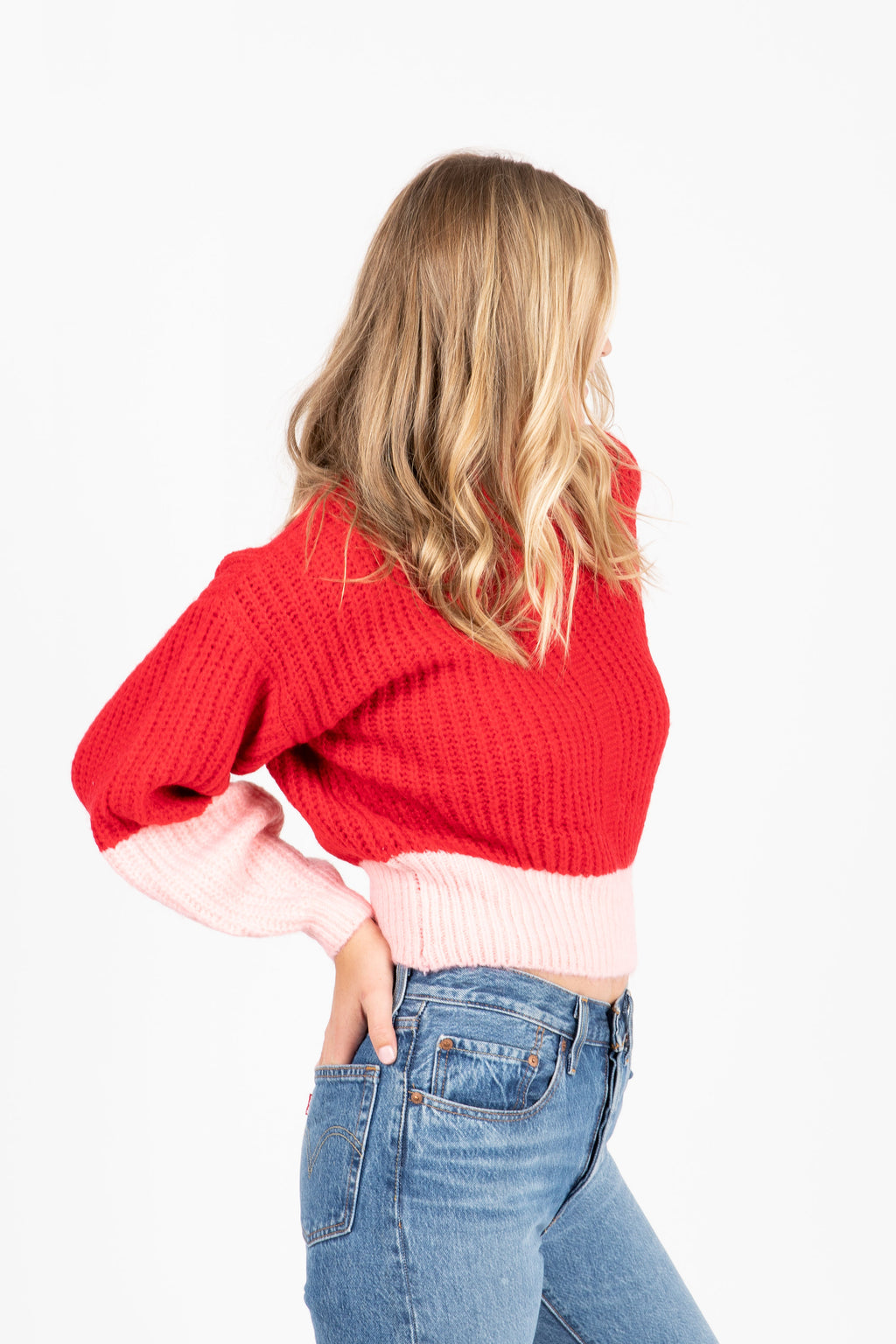 The Lewis Colorbolock Sweater in Red- studio shoot; side view