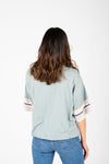 The Finley Striped Boxy Tee in Sage, studio shoot; back view