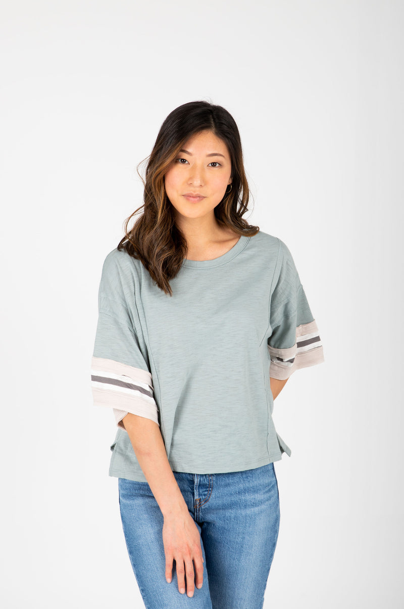 The Finley Striped Boxy Tee in Sage, studio shoot; front view