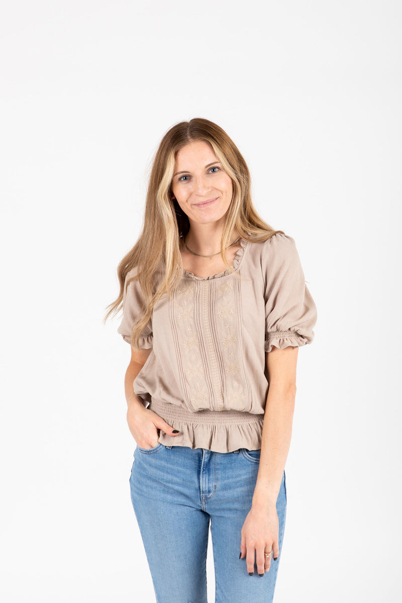 The Denise Smocked Lace Blouse in Taupe, studio shoot; front view