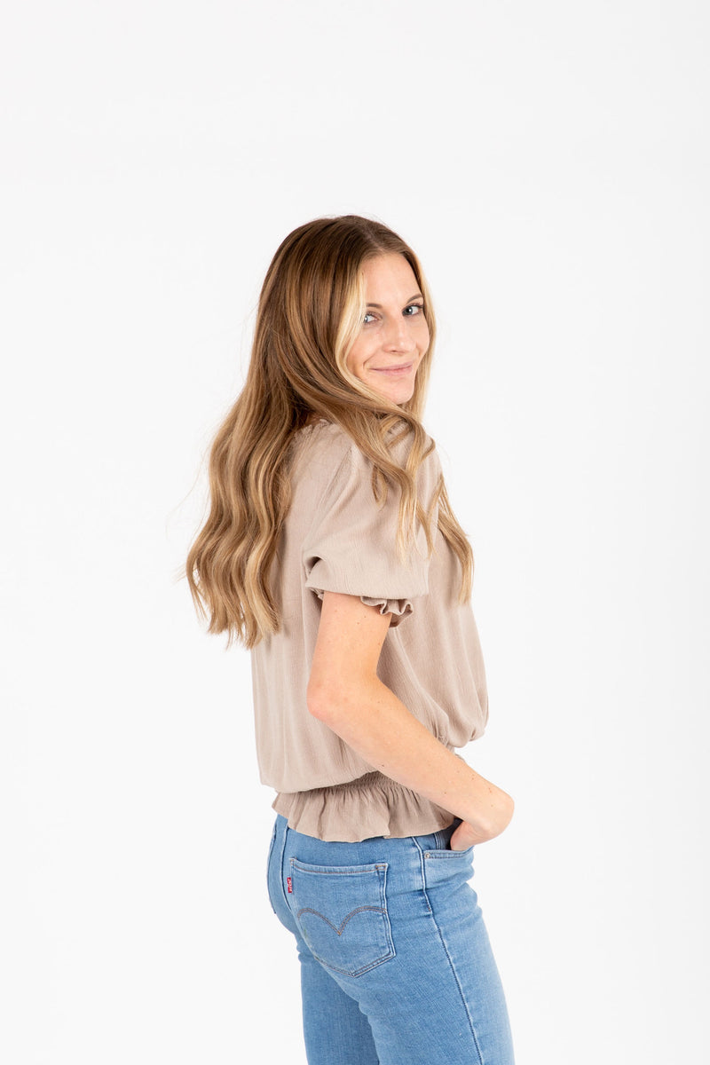 The Denise Smocked Lace Blouse in Taupe, studio shoot; side view