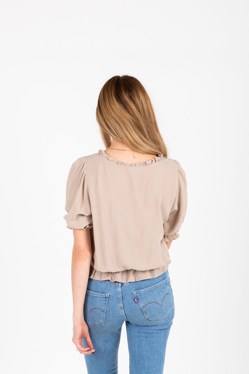 The Denise Smocked Lace Blouse in Taupe, studio shoot; back view