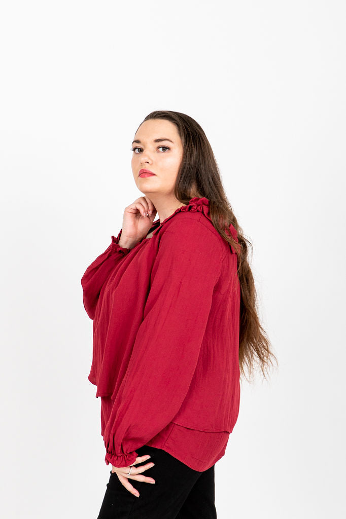 The Phelps Ruffle Blouse in Poppy, studio shoot; side view