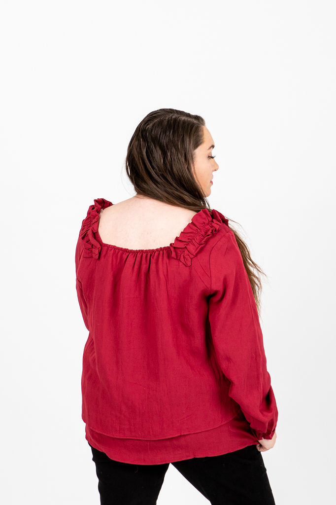 The Phelps Ruffle Blouse in Poppy, studio shoot; back view
