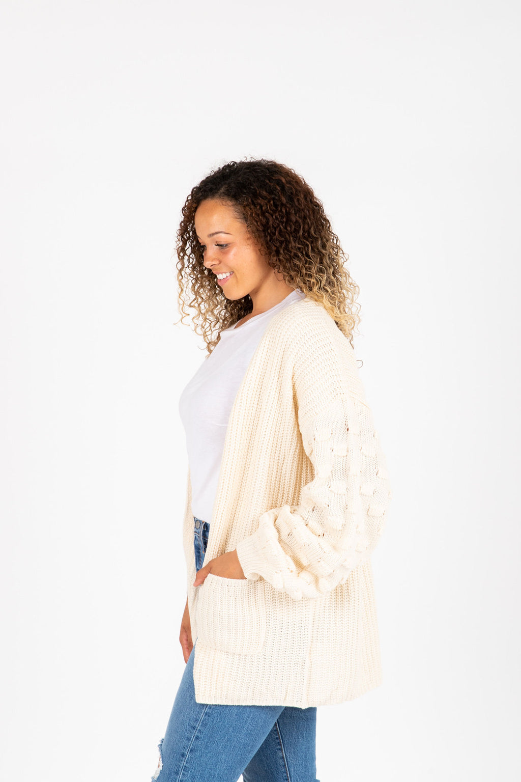 The Bellisario Crochet Detail Cardigan in Cream, studio shoot; side view