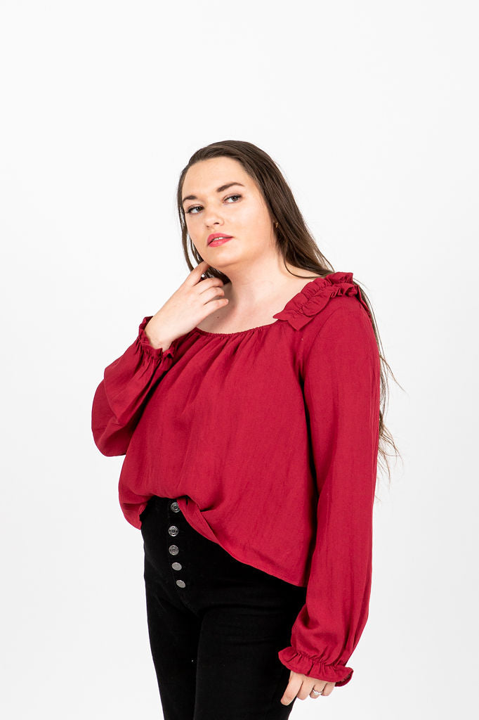 The Phelps Ruffle Blouse in Poppy, studio shoot; front view