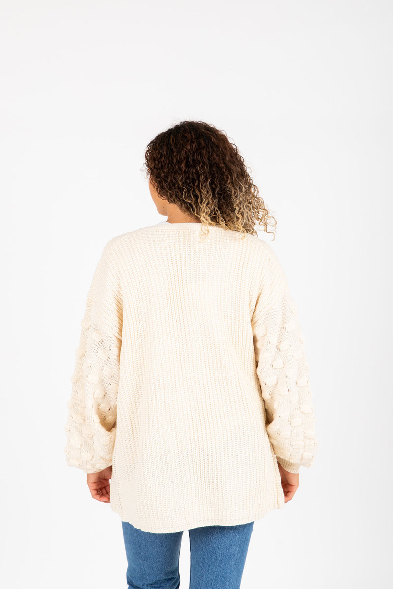The Bellisario Crochet Detail Cardigan in Cream, studio shoot; back view