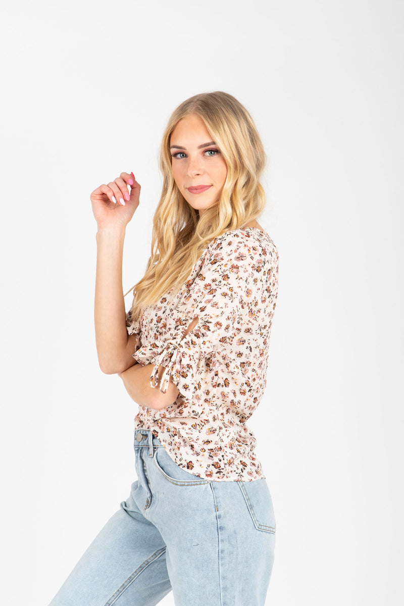The Devyn Floral Blouse in Mauve, studio shoot; side view
