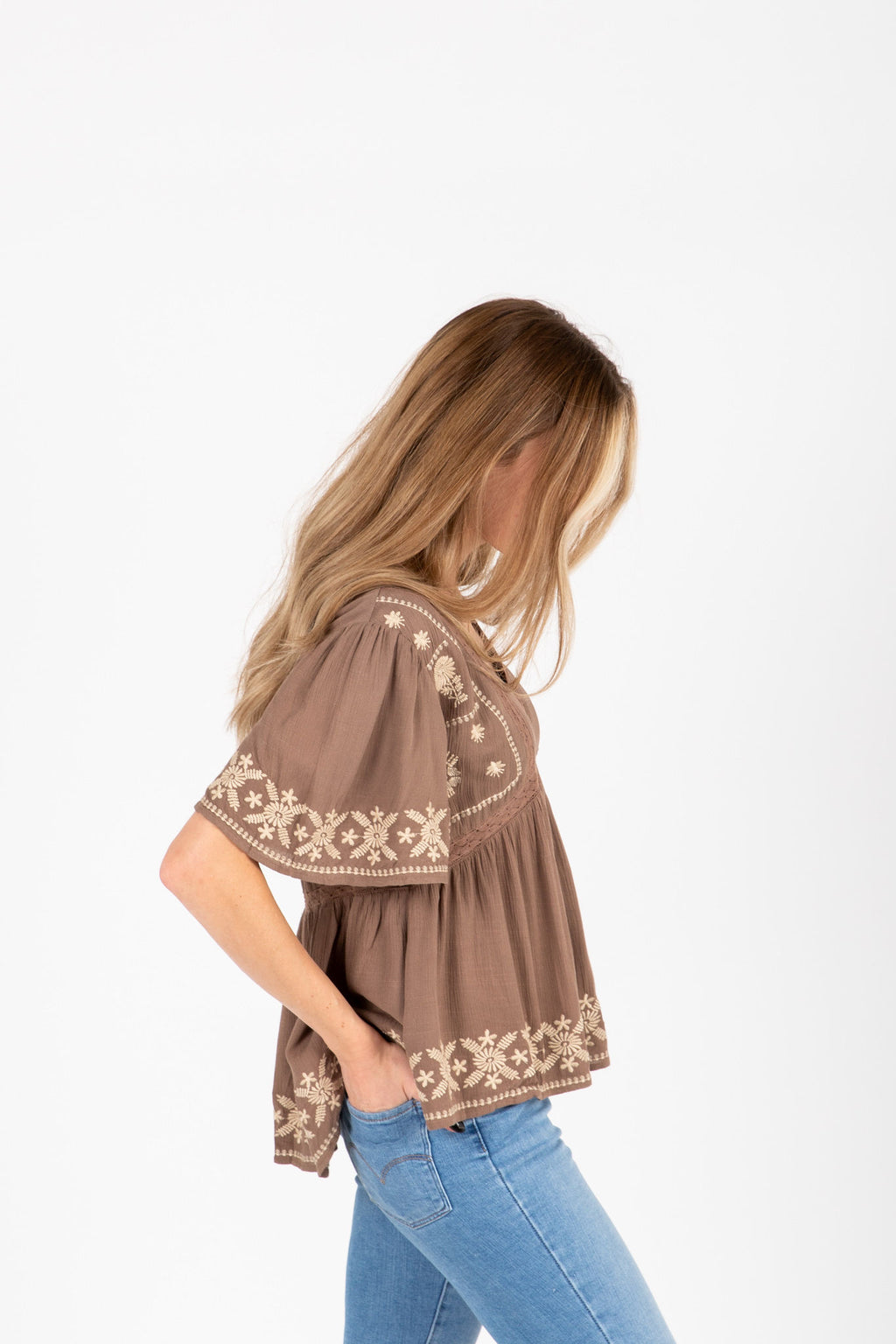 The Tempo Embroidered Blouse in Cocoa, studio shoot; side view