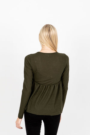 The Dursley Waffle Empire Peplum in Olive, studio shoot; back view