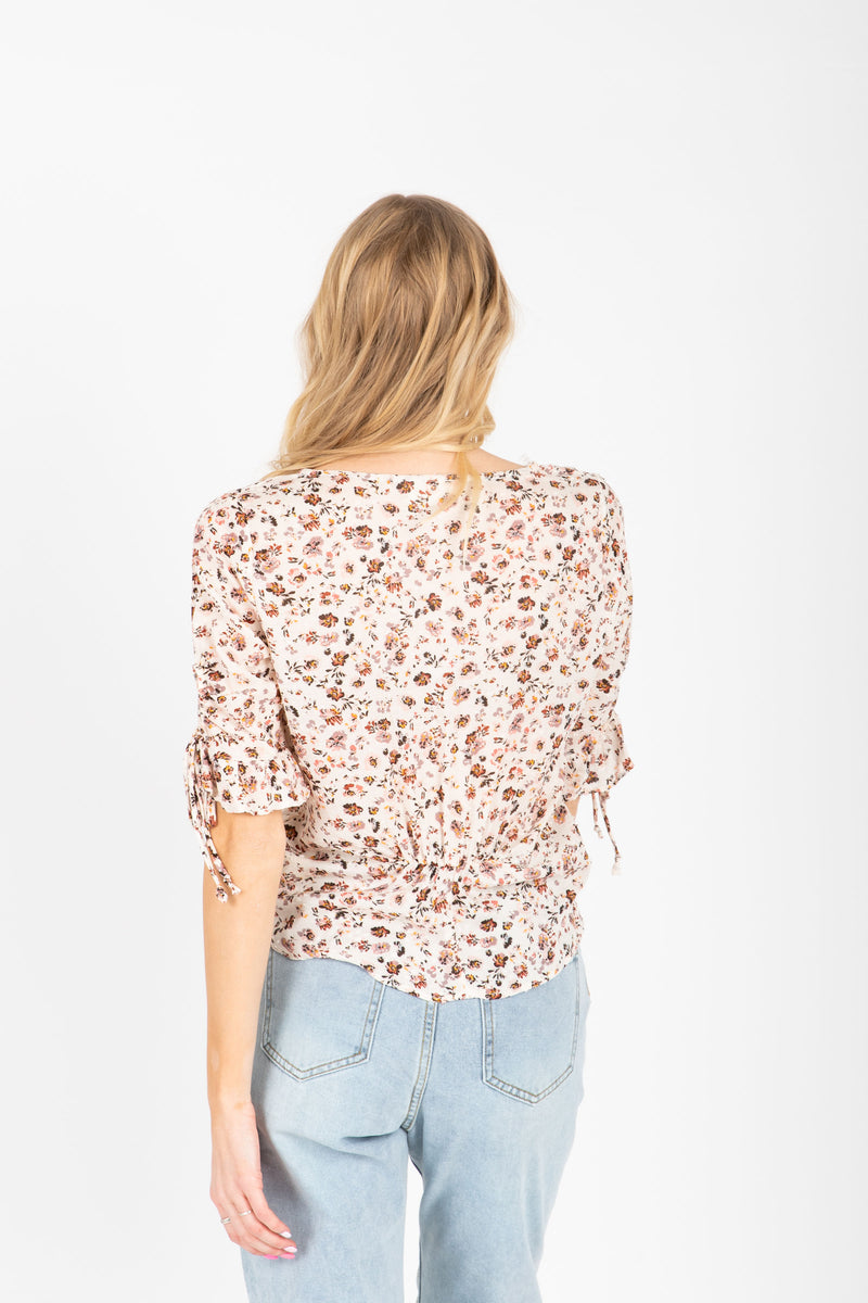 The Devyn Floral Blouse in Mauve, studio shoot; back view