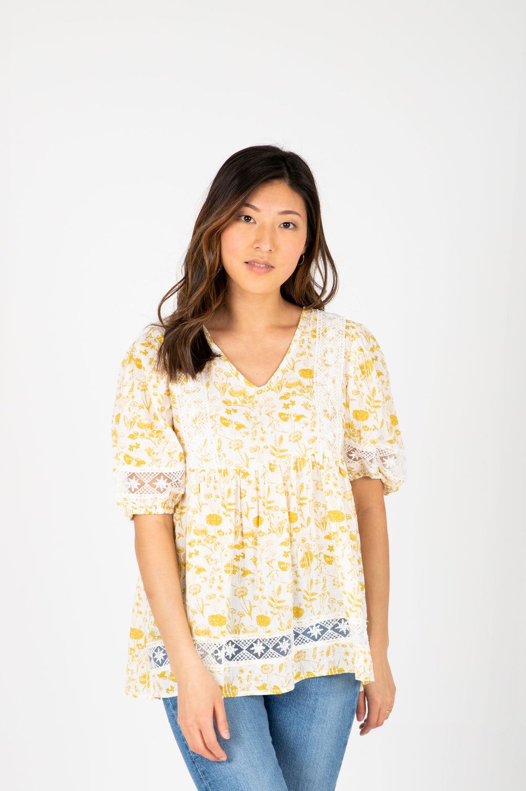 The Maggie Floral Lace Blouse in Mustard, studio shoot; front view