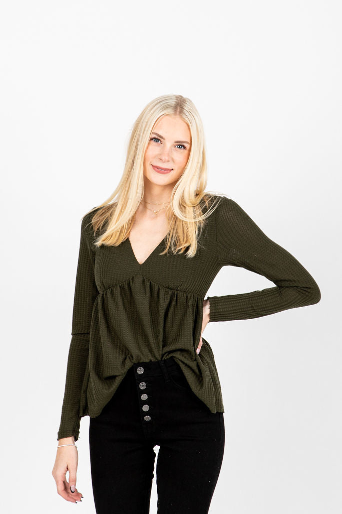 The Dursley Waffle Empire Peplum in Olive, studio shoot; front view