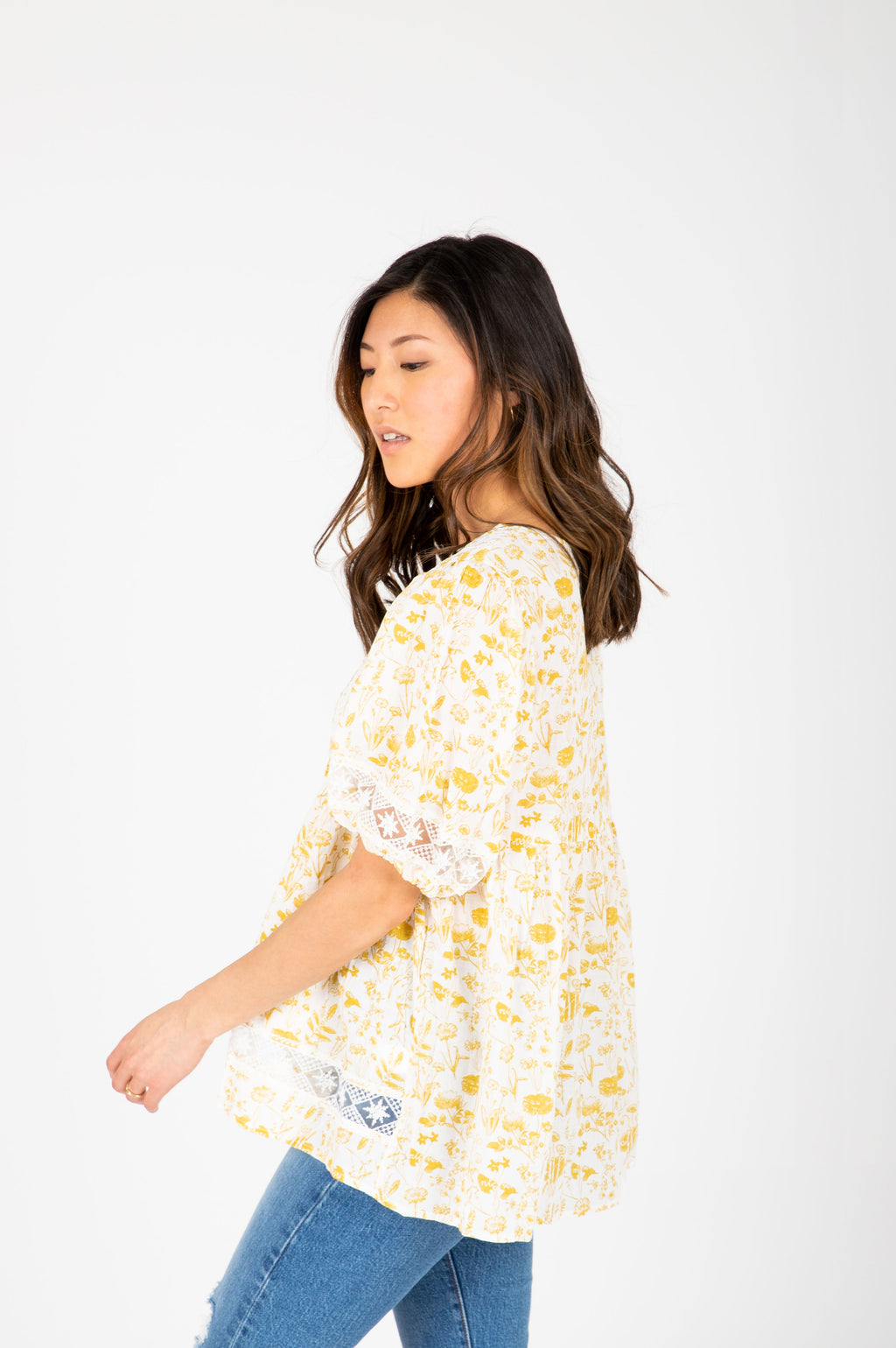 The Maggie Floral Lace Blouse in Mustard, studio shoot; side view