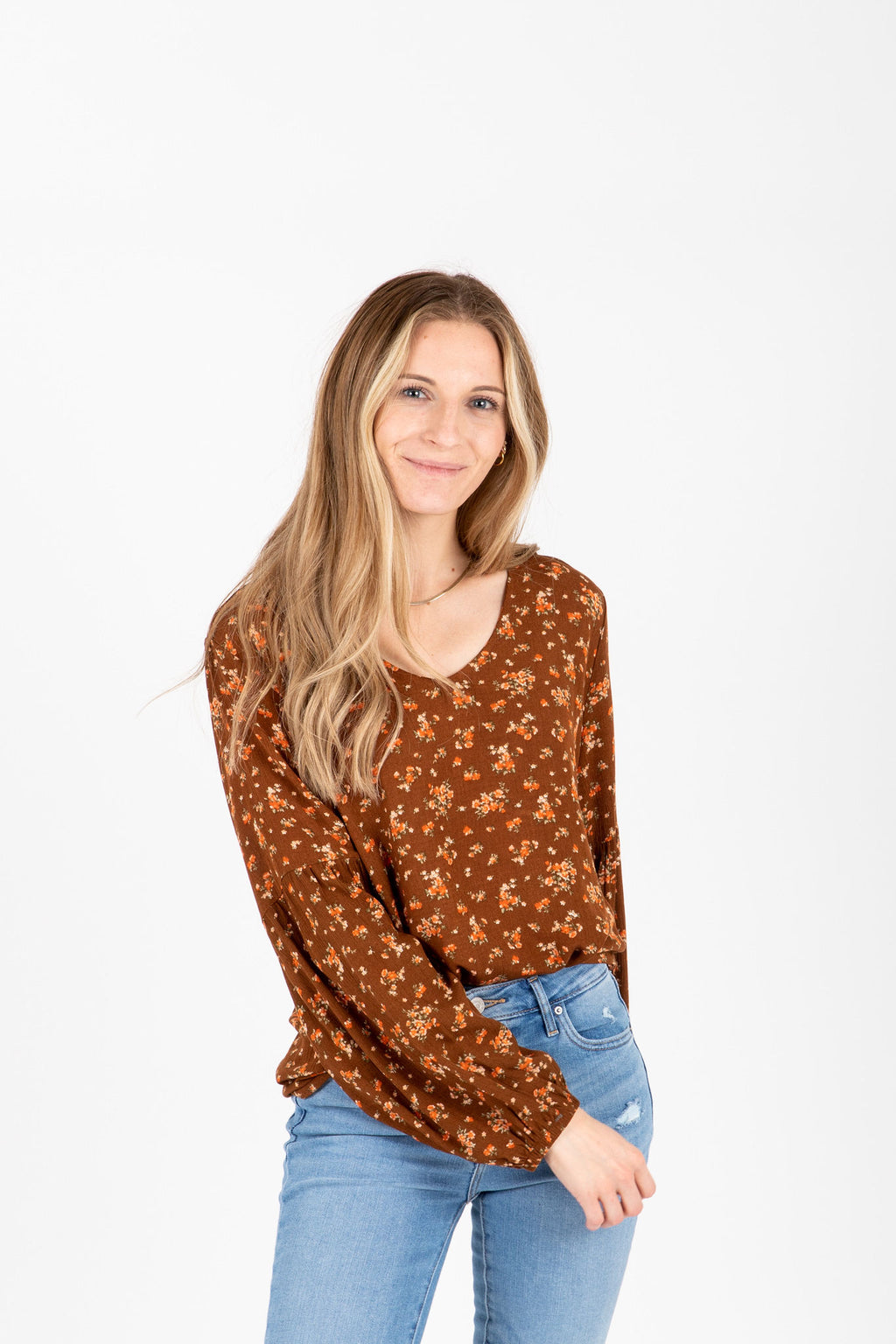 The Aria Floral Blouse in Camel, studio shoot; front view