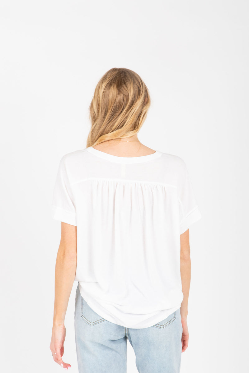 The Miraya Button Tie Front Blouse in White, studio shoot; back view