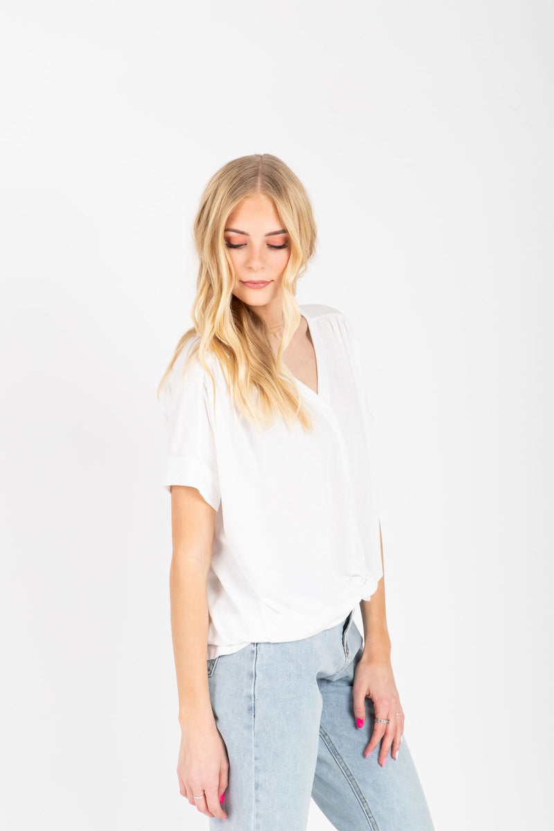 The Miraya Button Tie Front Blouse in White, studio shoot; side view