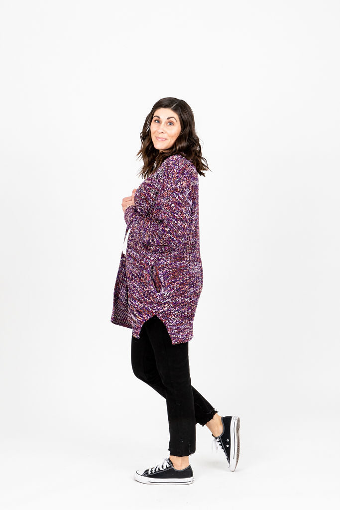 The Petunia Knit Cardigan in Plum Mix, studio shoot; side view