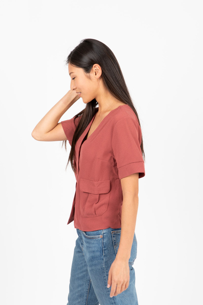 The Roaring Button Up Blouse in Brick- studio shoot; side view