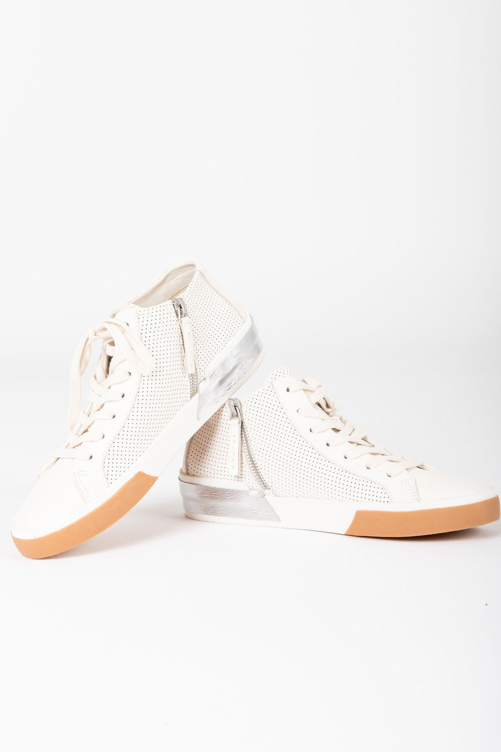 Dolce Vita: Zoel Sneakers in White Perforated Leather, studio shoot; side view