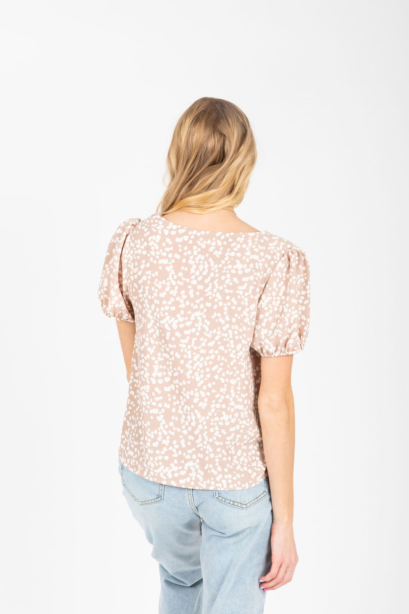 The Alayna Patterned Button Blouse in Natural, studio shoot; back view