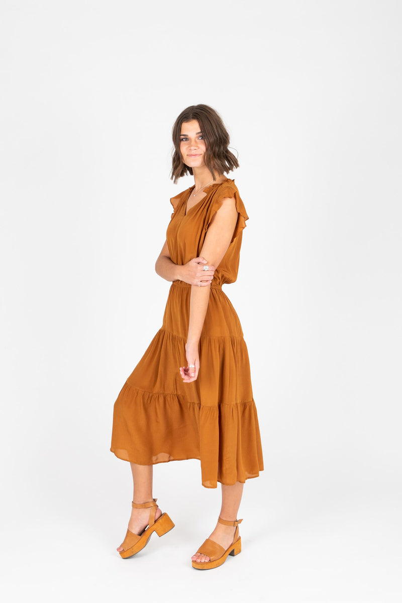 The Valko Ruffle Dress in Camel, studio shoot; side view