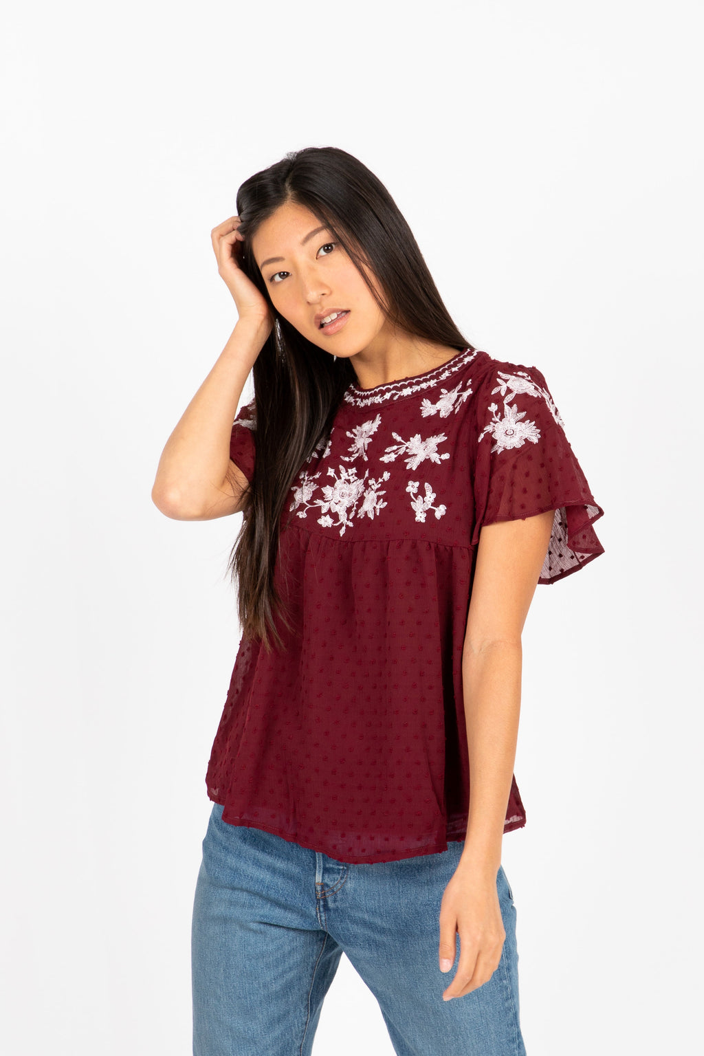 The Fixate Embroidered Swiss Dot Blouse in Burgundy- studio shoot; front view