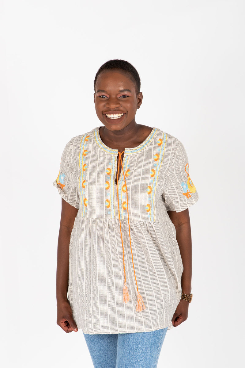 The Jaden Embroidered Striped Blouse in Taupe, studio shoot; front view