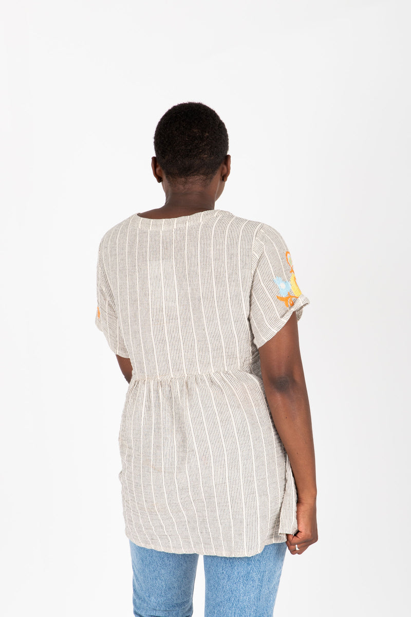 The Jaden Embroidered Striped Blouse in Taupe, studio shoot; back view