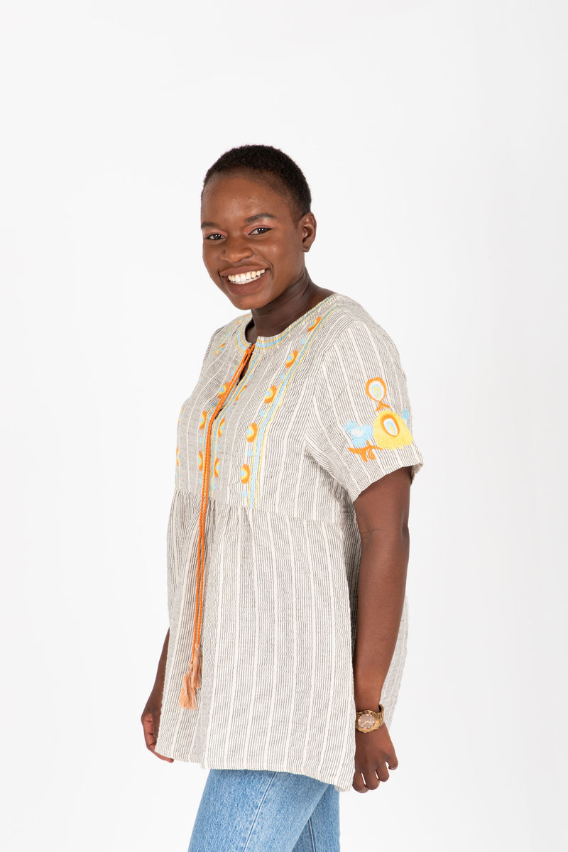 The Jaden Embroidered Striped Blouse in Taupe, studio shoot; side view