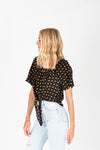 The Brock Patterned Tie Front Blouse in Black, studio shoot; side view