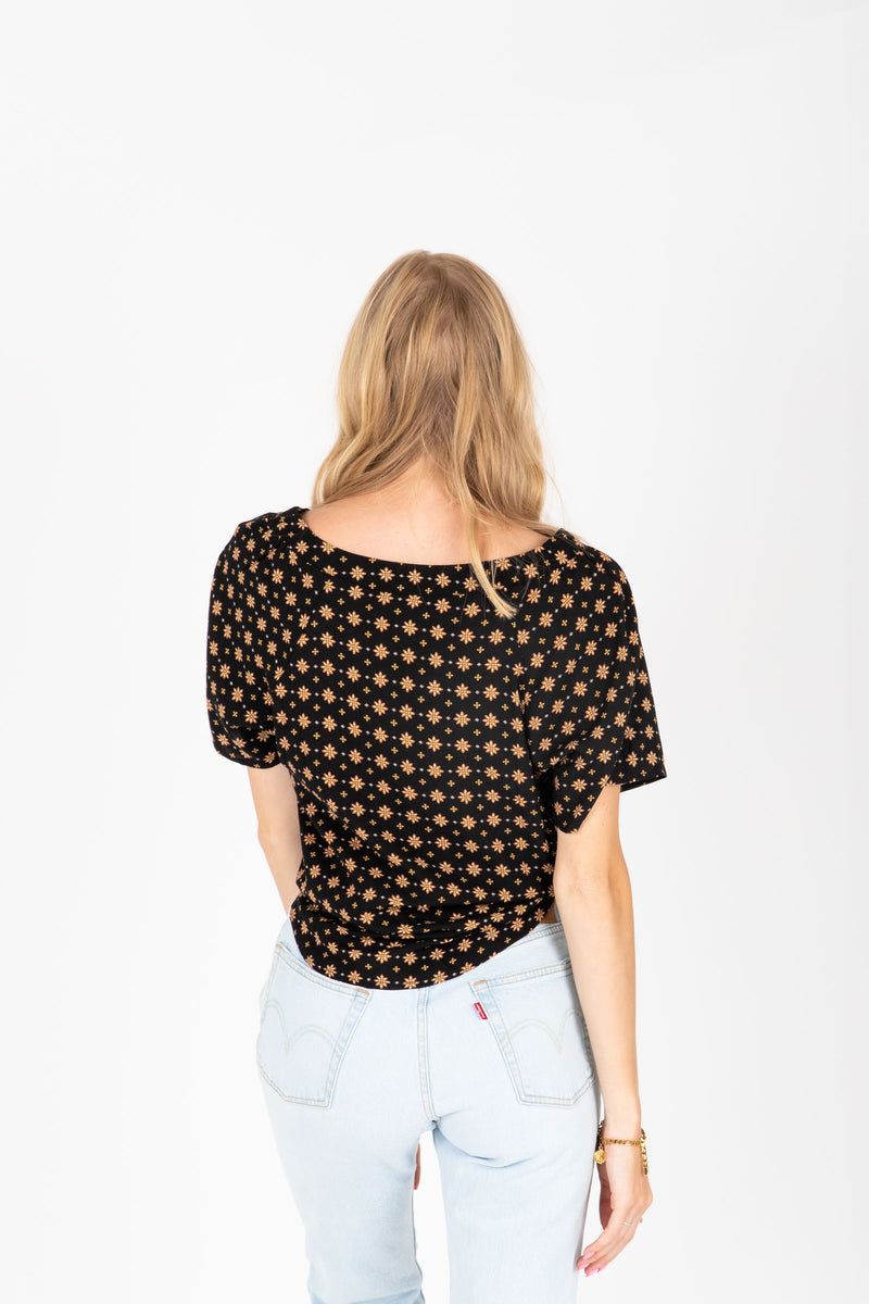 The Brock Patterned Tie Front Blouse in Black, studio shoot; back view