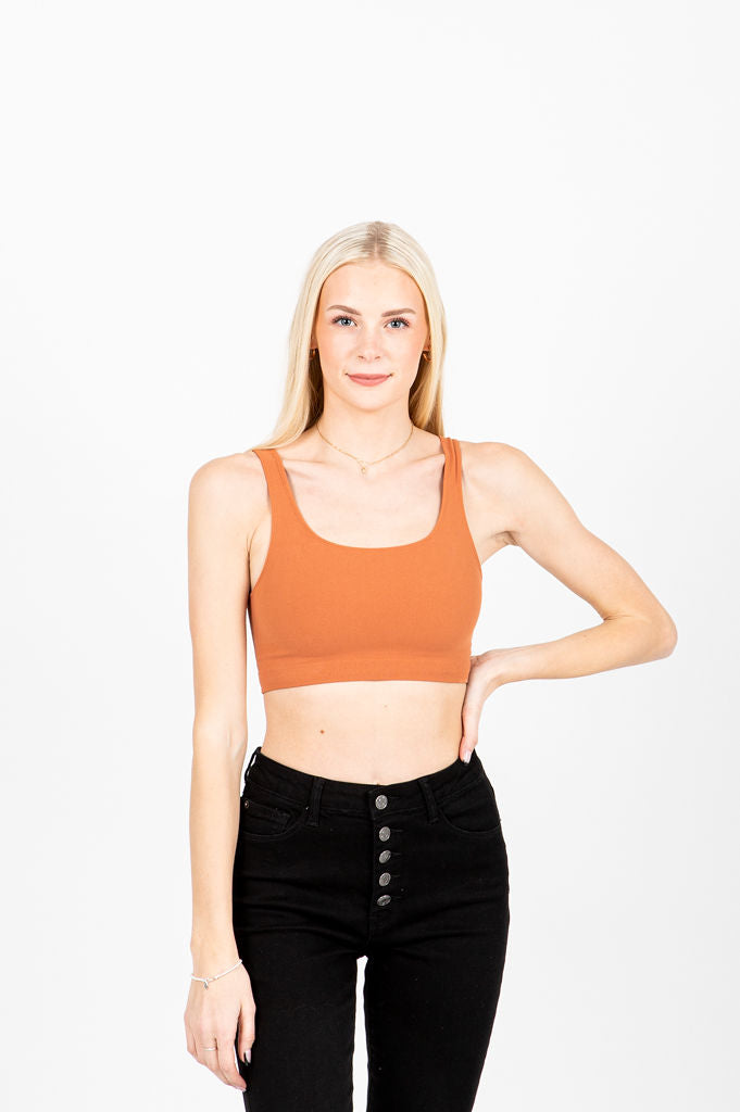 The Moody Ribbed Crop Tank in Persimmon, studio shoot; front view