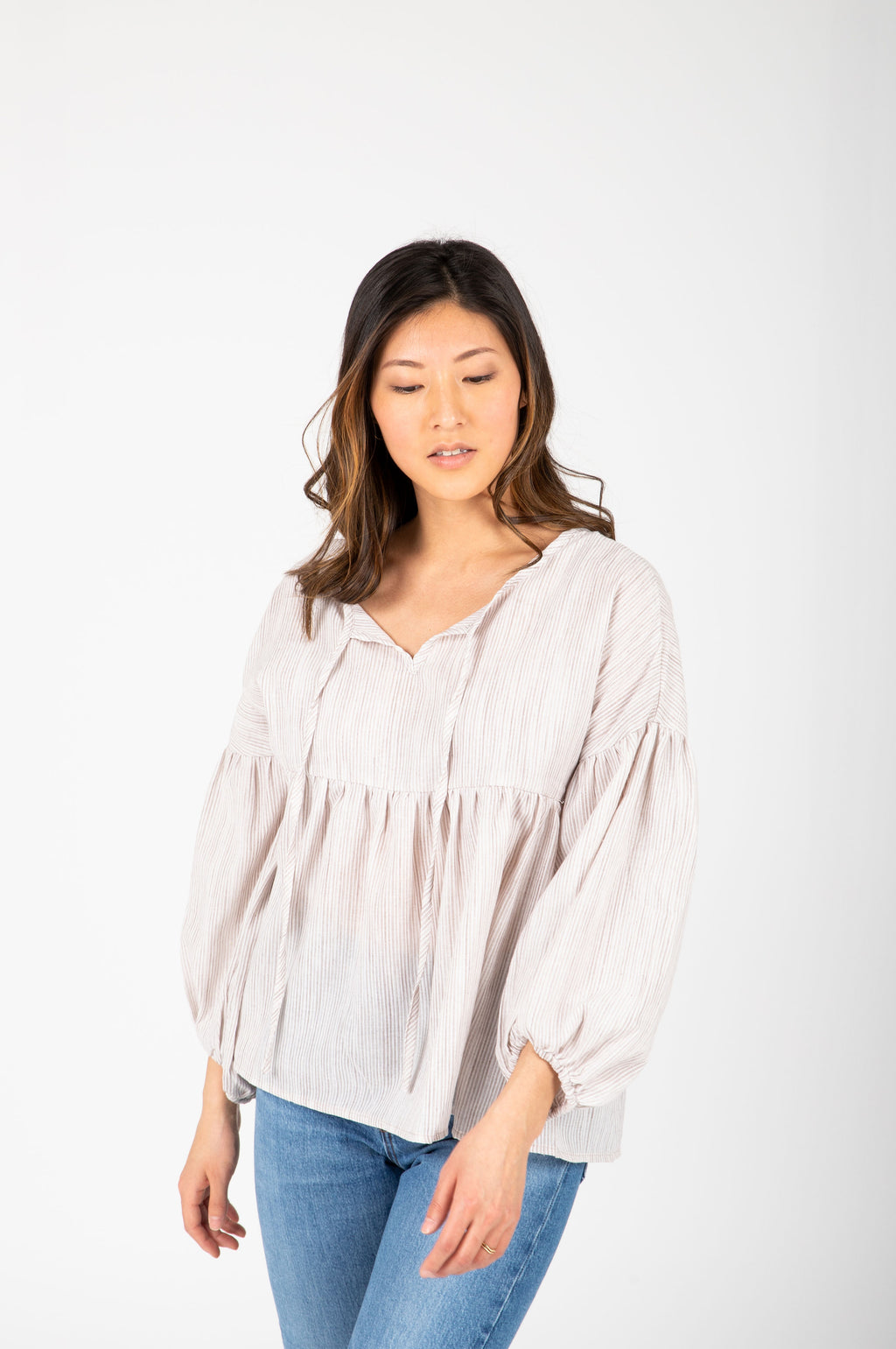 The Ruth Striped Puff Sleeve Blouse in Taupe, studio shoot; front view