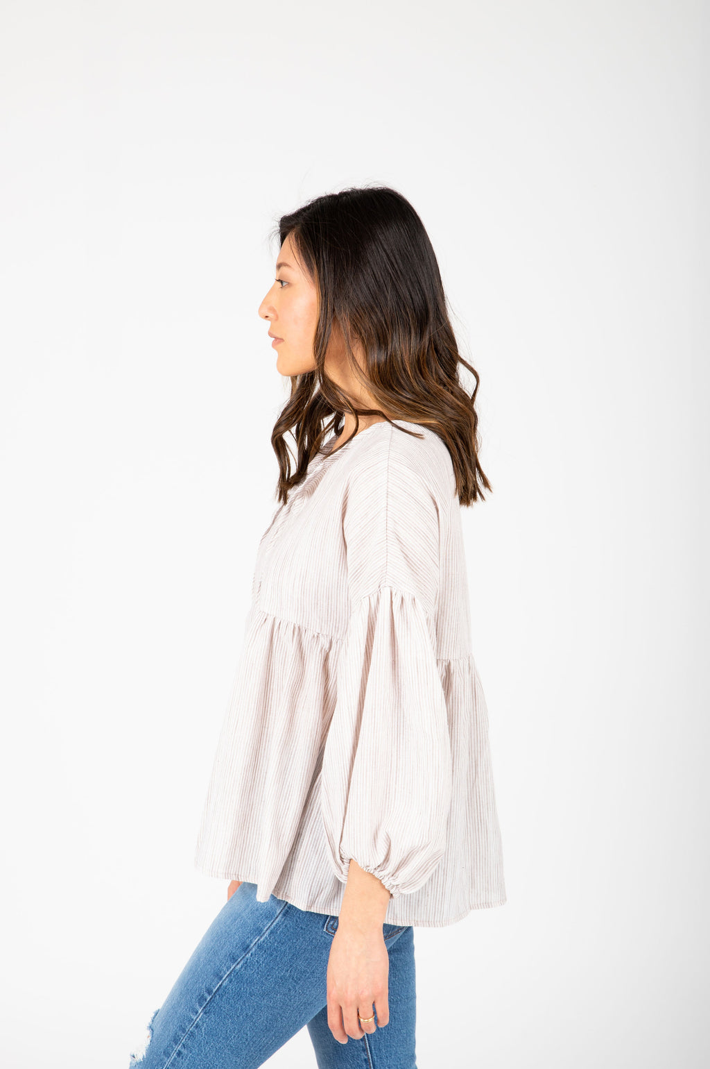 The Ruth Striped Puff Sleeve Blouse in Taupe, studio shoot; side view