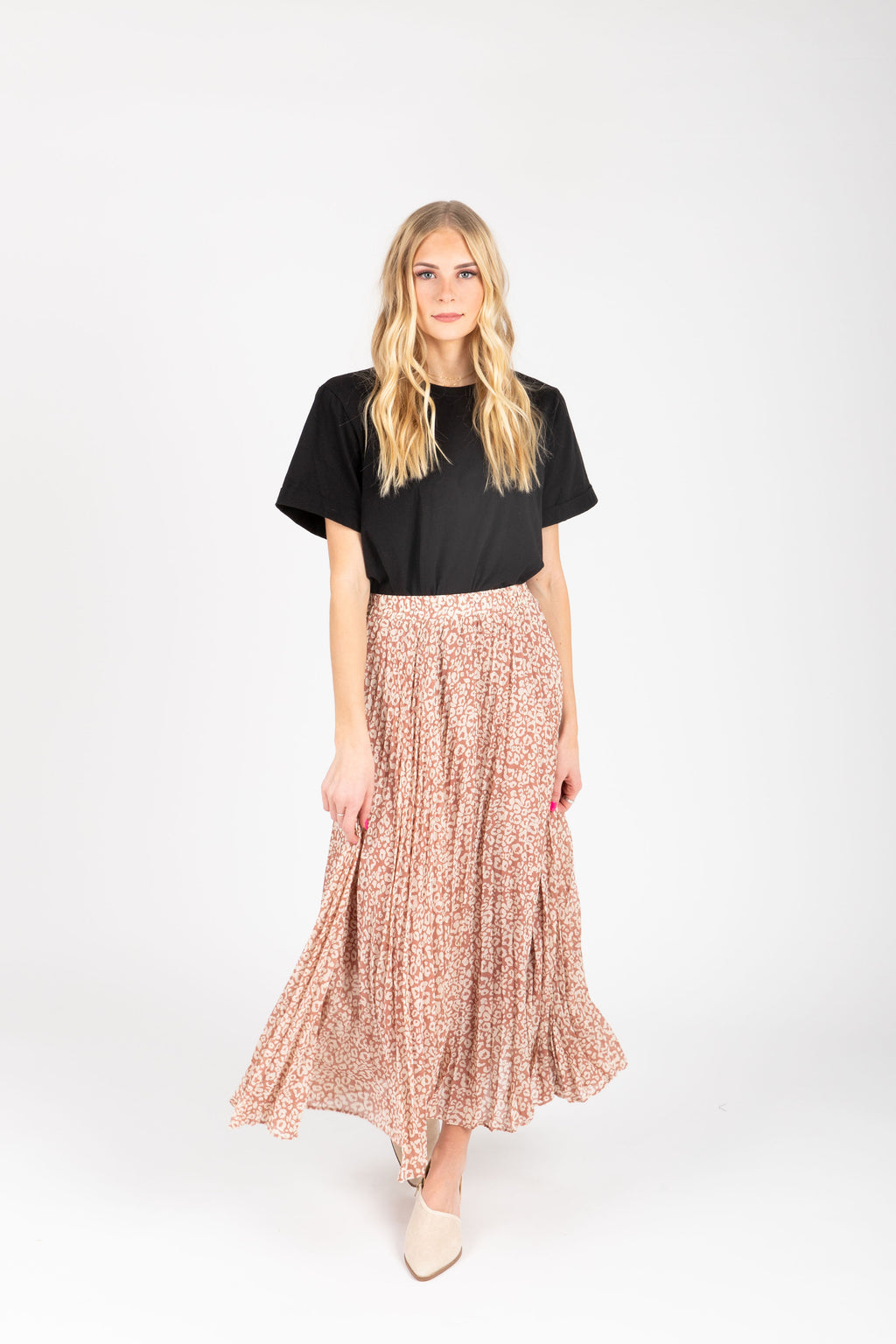 The Palmer Pleated Leopard Print Skirt in Dusty Rose, studio shoot; front view