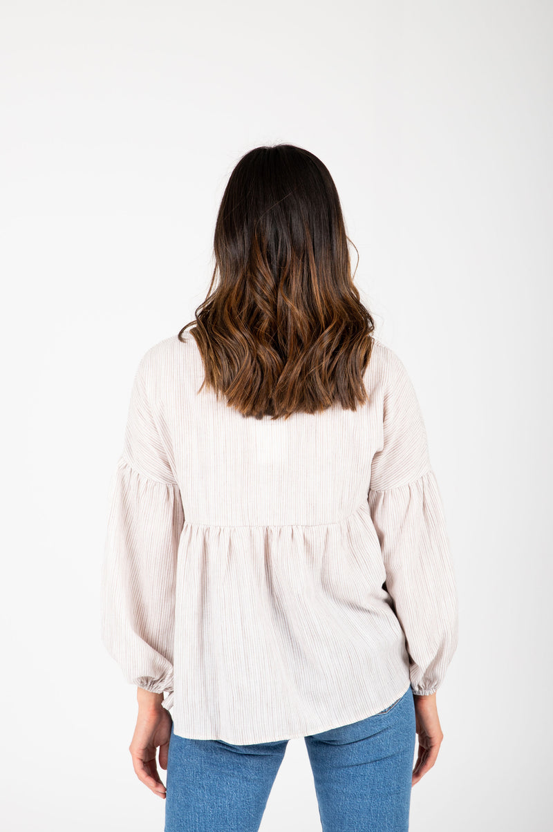 The Ruth Striped Puff Sleeve Blouse in Taupe, studio shoot; back view