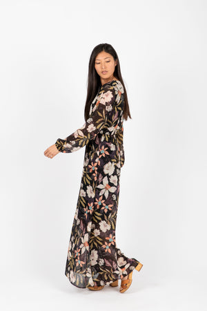 The Major Floral Wrap Maxi Dress in Black, studio shoot; side view