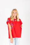 The Myles Embroidered Blouse in Red, studio shoot; front view