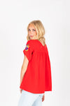 The Myles Embroidered Blouse in Red, studio shoot; back view